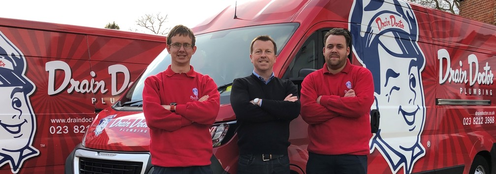 Drain Doctor franchise group of franchisees and their vans