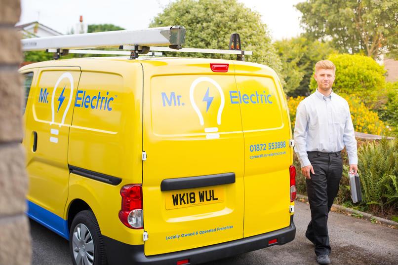 Mr Electric franchise man with his franchisee van