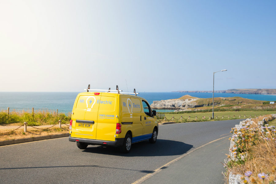 Mr Electric franchise van driving with scenic background