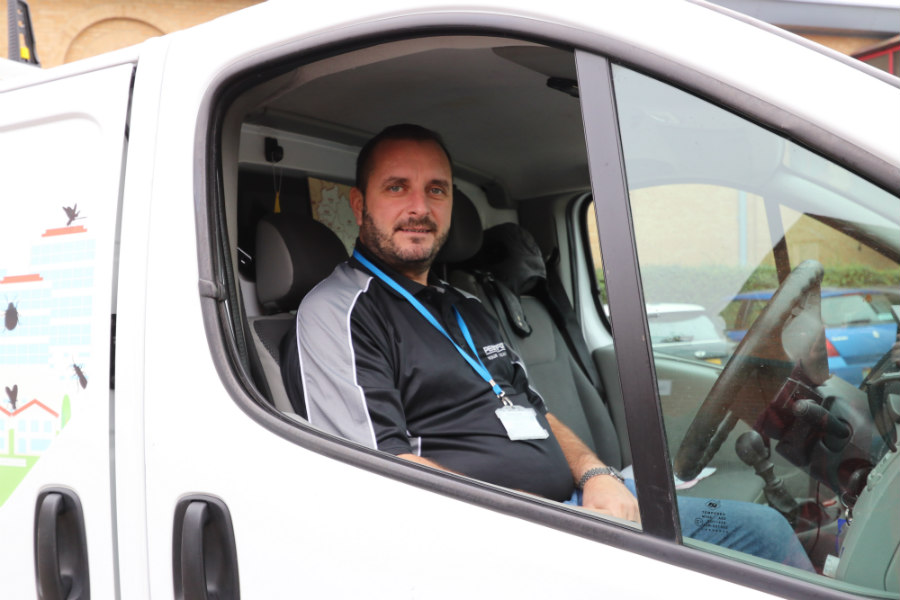 Pestforce franchise worker in his van