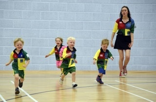Scrumys Franchise  group of young children running having fun