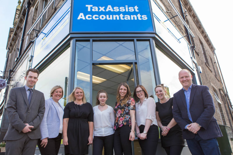 TaxAssist Accountants Franchise store with their team